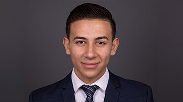 SEBS EOF student poses for headshot