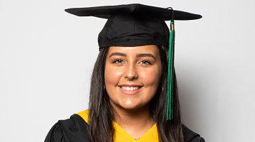 SEBS EOF student poses for graduation photo
